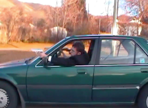 A screenshot from one of our movies. One of the only images of my car. Look at that sexy siding.